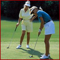 Females golfing